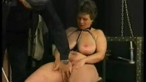 Classy babe is sitting on the chair, while her lover is drilling her soft pussy with a sex toy